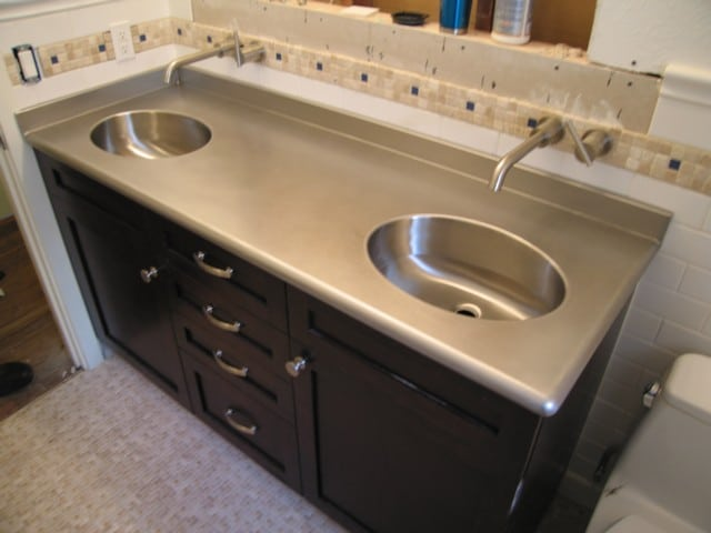 Bathroom and kitchen countertops pros and cons 3 3 for Stainless steel countertop with built in sink