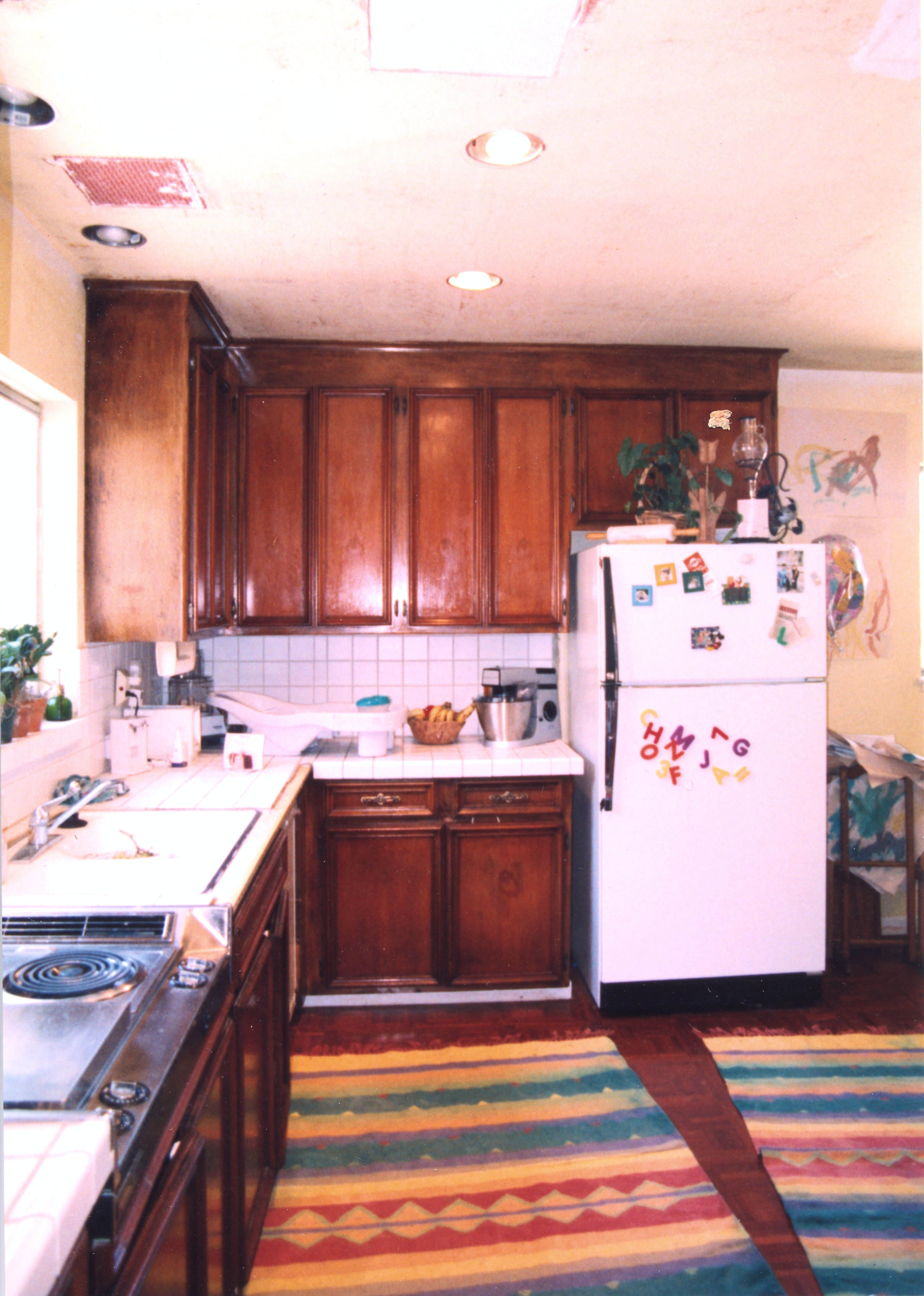 Before: Original cabinets were modified by previous owners to install a cooktop next to the sink, with D-I-Y wiring that wasn't to code.