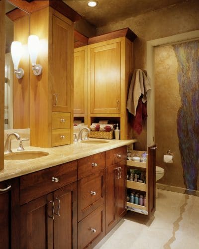 Remodeled Tigard master bathroom with new contrasting cabinets provide lots of storage